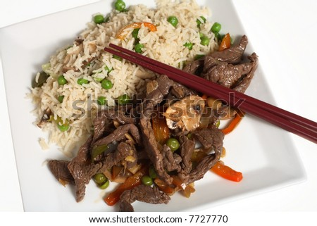 Asian-style stir-fried beef and vegetable fried rice. - stock photo