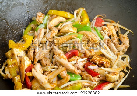 Asian style stirfry vegetables in a wok - stock photo
