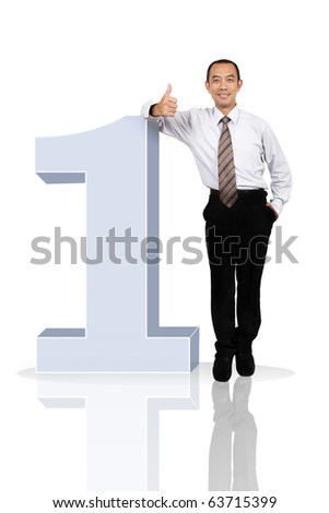 Asian successful businessman stand with NO.1 - stock photo