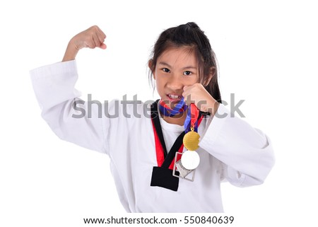 Asian taekwondo girl showing her gold medal on with background.