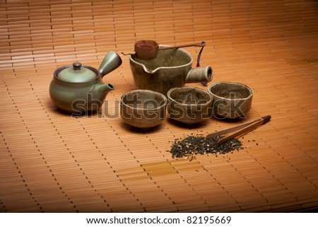 asian tea set on bamboo mat