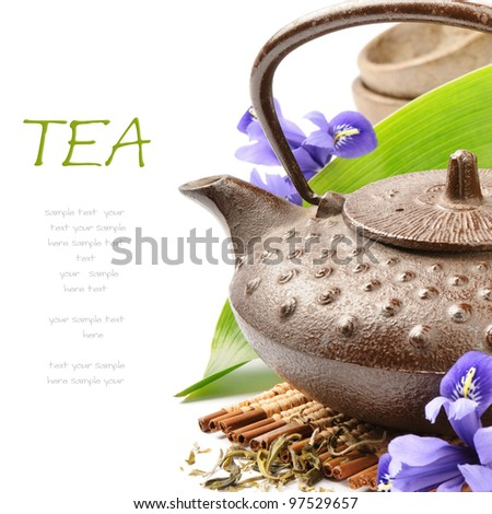 Asian tea set with green leaf and flowers - stock photo