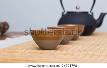asian tea set with pink flower and towels - stock photo