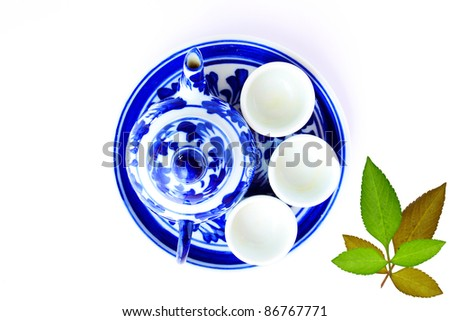 Asian tea set with pot and cups from top view - stock photo