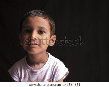 Asian teenage boy posing in the dark room