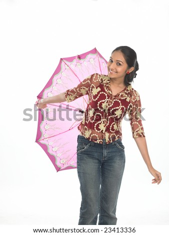 Asian teenage girl playing with the umbrella - stock photo