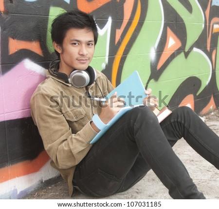 Asian teenage student studying - stock photo