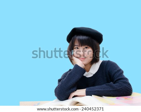 Asian teenager student with blue background. - stock photo