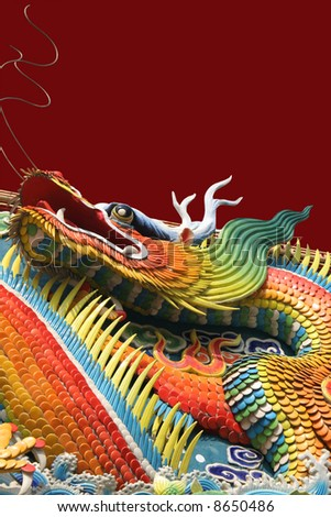 Asian temple dragon isolated on red background - stock photo