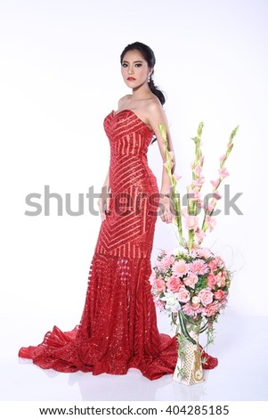 Asian Thai Female Model People with Tan Skin on Fashion Make Up with Studio Lighting on White Background, Red Sexy Evening Gown with flower Bouquet by side, full body