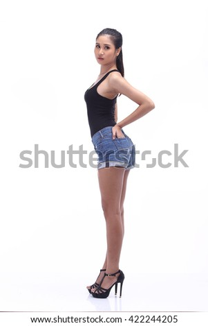 Asian Thai Female Model with Tan Skin on Black Vest Short Jean with Studio Lighting on White Background, Black High Heel