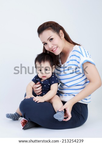 Asian Thai mom and pretty son smiling isolated - stock photo