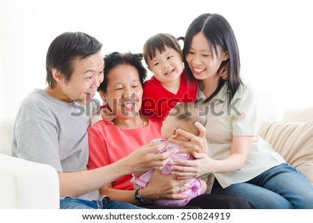 Asian three generations family enjoying family time. - stock photo