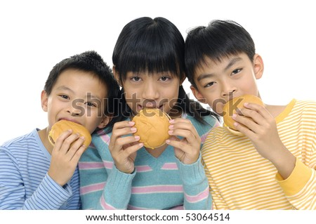 Asian three young friends eating hamburgers - stock photo
