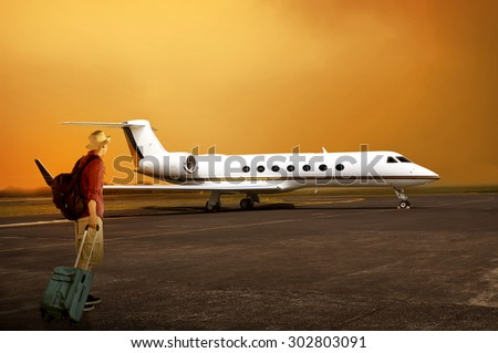 Asian traveler man walking to the plane. Travel concept - stock photo