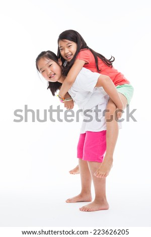 Asian two girls carry on isolated on white.  - stock photo