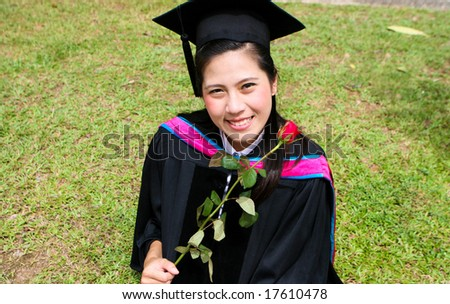 Asian university graduate with a red rose.