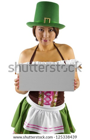 Asian waitress in a St Patricks Day costume holding a sign. - stock photo