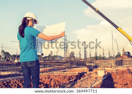 asian wamen civil or construction Engineer In spec quality construction work.vintage photo - stock photo