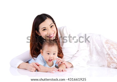 Asian woman and her six months old baby boy lying on the floor - stock photo