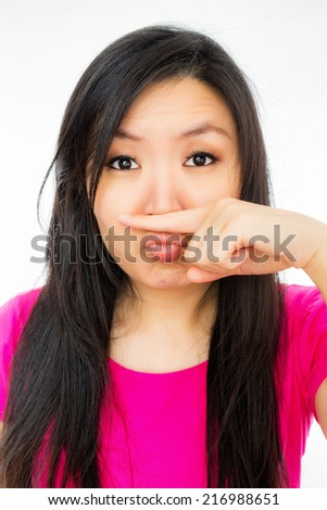 Asian woman annoyed by a bad smell