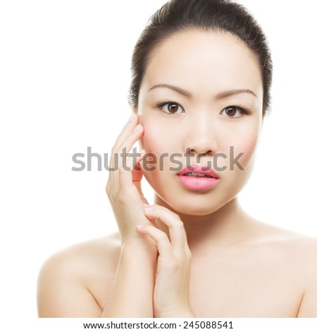 Asian woman beauty face closeup portrait. Beautiful attractive mixed race Chinese Asian / Caucasian female model with perfect skin, manicure and day make up, isolated on white background