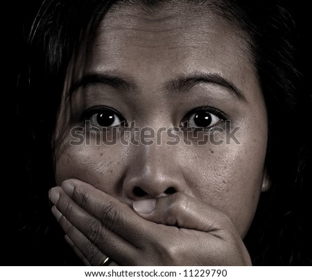 Asian woman being silenced - stock photo