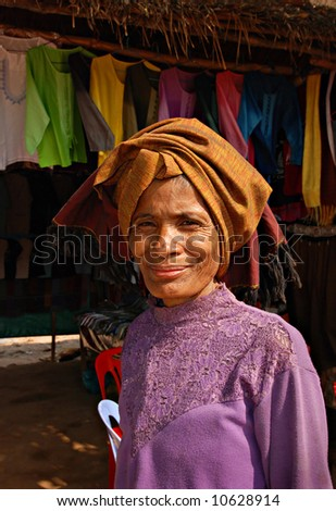 Asian woman, Cambodian, trader in traditional national market - stock photo