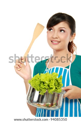 asian woman cooking in the kitchen