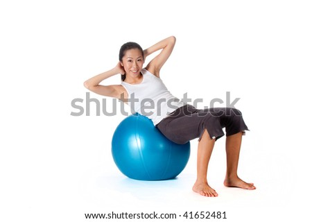 Asian woman doing sit up on blue yoga ball on white background