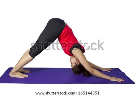 asian woman doing yoga against white background - stock photo