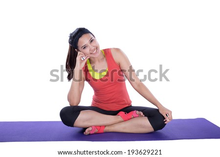 asian woman doing yoga isolated on white background - stock photo