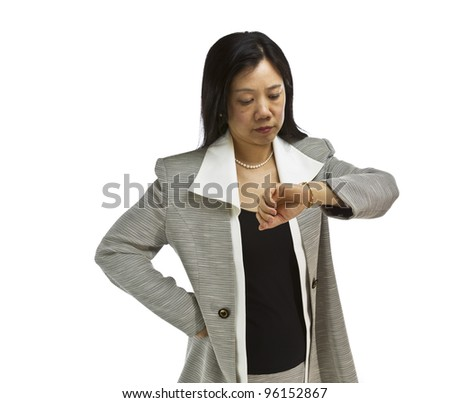 Asian woman dressed in business formal looking at wach on white background - stock photo