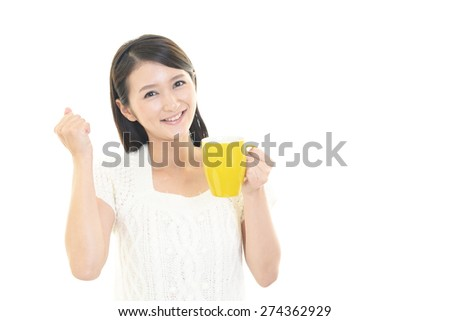 Asian woman drinking a cup of coffee - stock photo