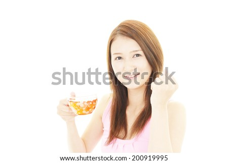 Asian woman drinking cup of tea