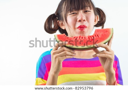Asian woman eating watermelon .