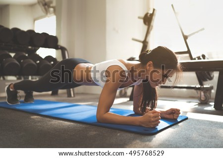"Asian woman exercising in the gym, she was pretending to ""plank"""