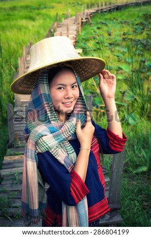 Asian woman farmer go to work in countryside.The simple life. Asian woman traditional dress. - stock photo