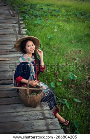 Asian woman farmer go to work in countryside.The simple life.Asian woman traditional dress. - stock photo