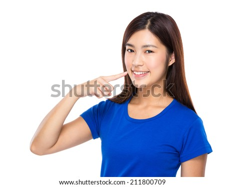 Asian woman finger point to teeth