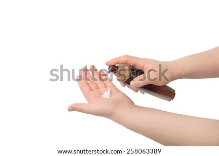 asian woman hand hold lotion, isolated on white - stock photo