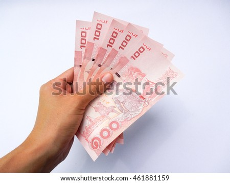 asian woman hand hold thai bath currency on white background