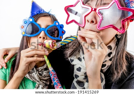 asian woman having a  party shooting in studio - stock photo