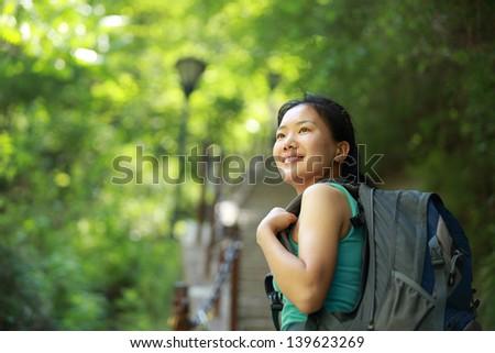 asian woman hiker climb mountain - stock photo