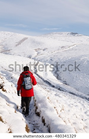Asian woman hiking in snow