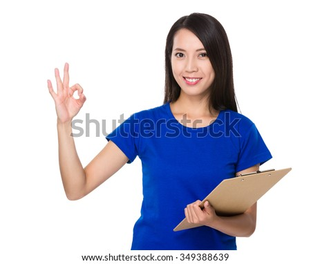 Asian Woman hold with clipboard and ok sign gesture - stock photo