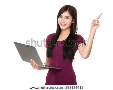 Asian woman hold with laptop computer and finger point upwards