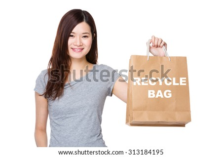 Asian Woman hold with shopping bag for showing phrase of recycyle bag
