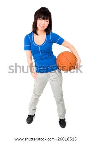 Asian woman holding basketball ball on white - stock photo