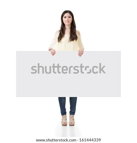 Asian woman holding blank board, full length portrait on white background. - stock photo